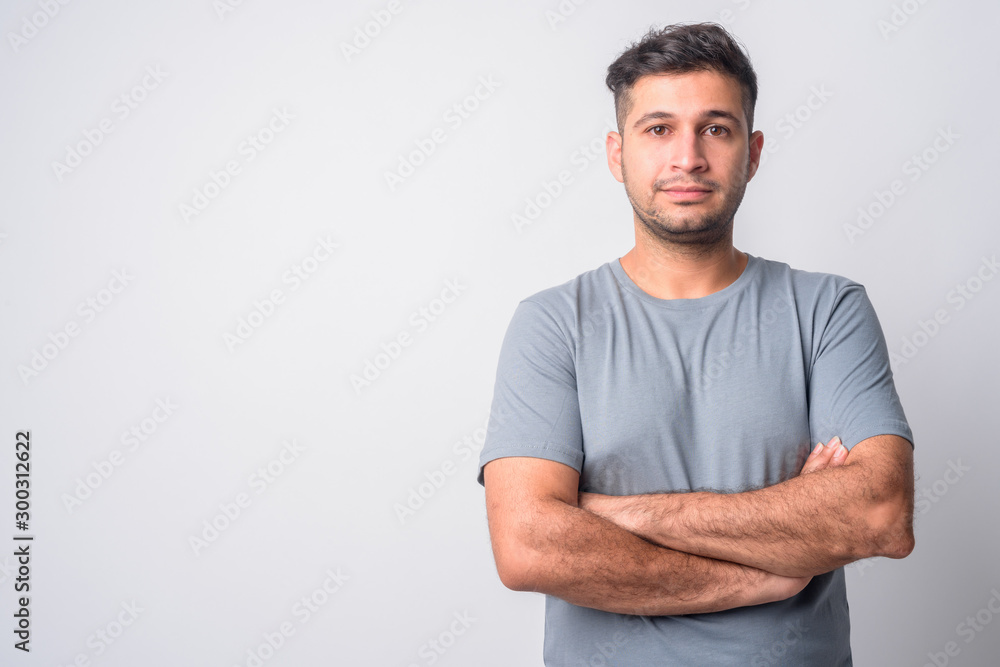 Fototapety, obrazy: Portrait of young handsome Persian man with arms crossed