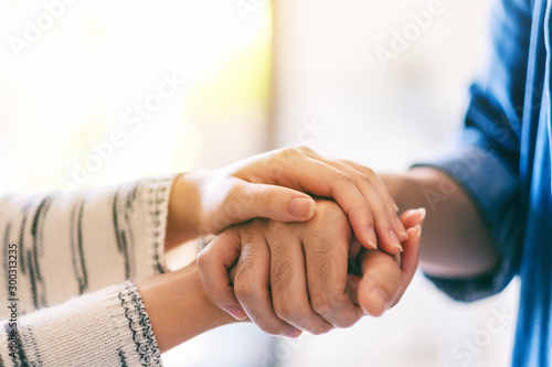 A man and a woman holding each other hands for comfort and sympathy Canvas Print