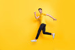 Full length body size view of his he nice attractive sportive cheerful cheery guy running fast motivation isolated over bright vivid shine vibrant yellow color background