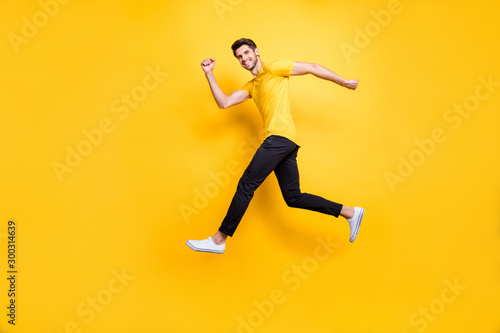 Full length photo of handsome guy jumping high speed running competition partici Canvas-taulu