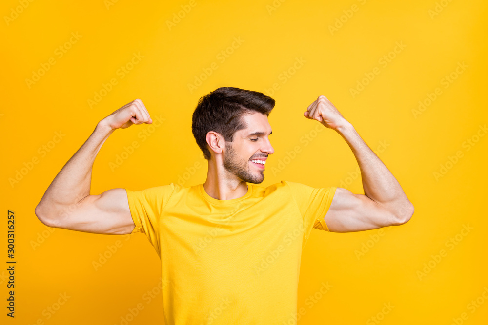 Fototapety, obrazy: Close-up portrait of his he nice attractive content strong sportive cheerful cheery guy demonstrating muscles isolated over bright vivid shine vibrant yellow color background