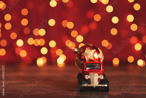 Cadres-photo bureau Vintage voitures Little red car toy on the Christmas tree on blurred background