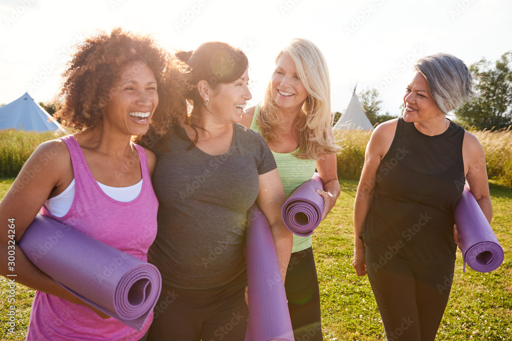 Fototapety, obrazy: Group Of Mature Female Friends On Outdoor Yoga Retreat Walking Along Path Through Campsite