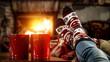 Leinwandbild Motiv Woman legs with christmas socks and fireplace in home interior.