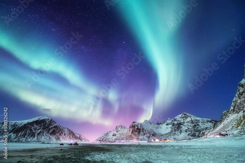 Foto auf AluDibond Turkis Aurora borealis on the Lofoten islands, Norway. Green northern lights above mountains. Night winter landscape with aurora. Natural background in the Norway