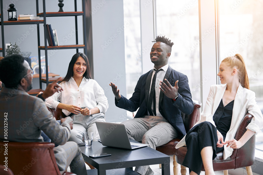 Fototapeta Business and Education concept. African business coach sit in office with colleagues