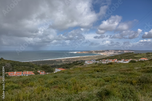 View at the Nazare Village with touristic beach, atlantic ocean and sky