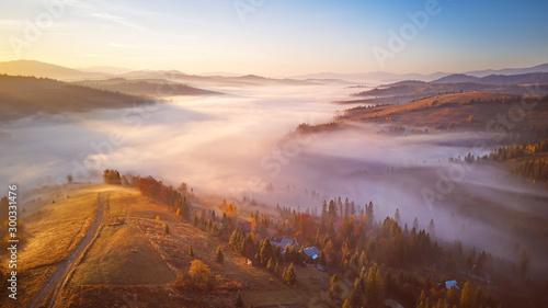 Beautiful November sunrise over mountain foggy valley. Wallpaper Mural