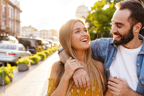 Happy lovely young couple in love spending time outdoors Canvas-taulu