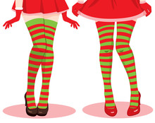 Two Female Legs Wearing Red And Green Christmas Stockings