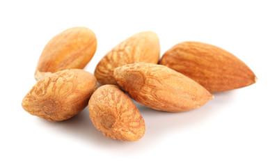 Tasty almonds on white background