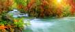 Leinwandbild Motiv Colorful majestic waterfall in national park forest during autumn, panorama - Image