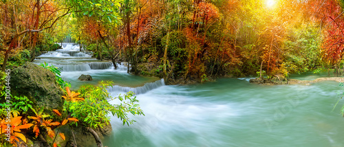 Fotobehang Bomen Colorful majestic waterfall in national park forest during autumn, panorama - Image