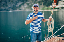 Portrait Of Senior Man Tying Knot And Securing A Mooring For His Hobby Yacht Sail Boat
