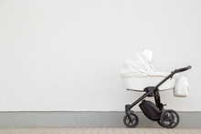 New, White Baby Stroller On Pa...