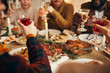 canvas print picture - Close up of modern adult people raising glasses while enjoying Christmas dinner at home, copy space
