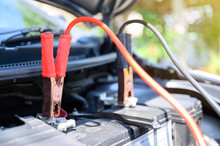 Close Up Battery Jumper Cables Connect To Car Battery For Charging Dead Battery