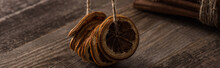 Dried Orange Slices On Thread And Cinnamon On Wooden Background, Panoramic Shot