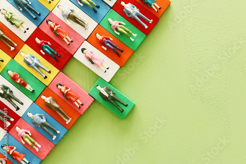 Photo  Business concept image of tangram puzzle blocks with people icons over wooden ta