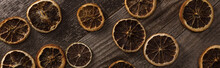 Top View Of Dried Citrus Slices On Wooden Brown Surface, Panoramic Shot
