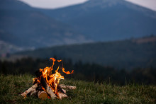 Burning Bonfire In The Evening In The Carpathian Mountains. Place For Inscription