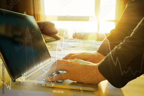Fotografía  stock market graph analysis, double exposure hand of business man or trader usin