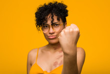 Young African American Woman With Skin Birth Mark Showing Fist To Camera, Aggressive Facial Expression.
