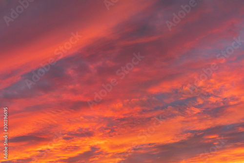 Dramatic fiery sky sunset cloudscape at dusk