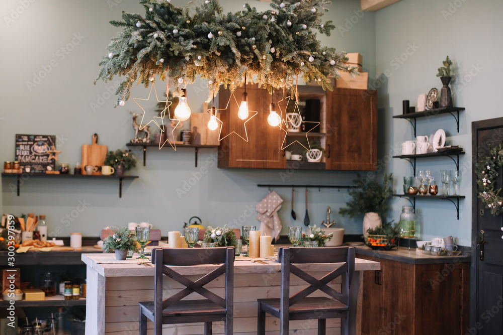 Fototapety, obrazy: Festive kitchen in Christmas decorations. Christmas dining room. Beautiful New Year decorated classic home interior. New Year and Christmas background