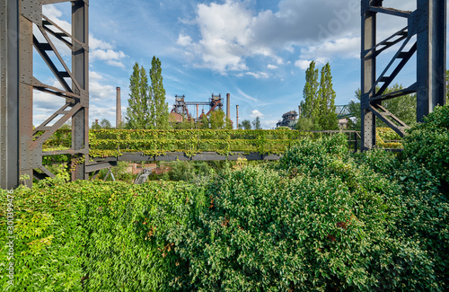 Autocollant pour porte Les vieux bâtiments abandonnés Industrial factory in Duisburg, Germany. Public park Landschaftspark, landmark and tourist attraction.