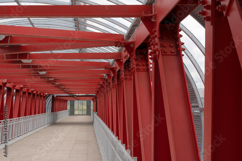 Printed kitchen splashbacks Historical buildings Pedestrian crossing, construction of red metal structures. The roof is made of steel channels connected to each other. Red iron beams on boltsю