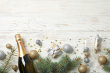Concept With Christmas Baubles And Champagne On White Wooden Background, Copy Space