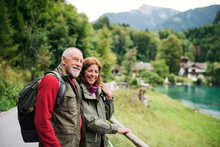 A Senior Pensioner Couple Hiking In Nature, Resting. Copy Space.
