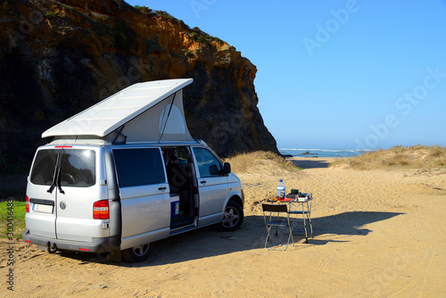 Photo Camping in a van on the beath of Vila Nova de Milfontes Praia Das Furnas, Portug