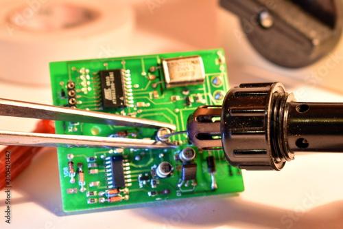 Valokuvatapetti Repairing a microchip detail