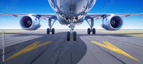 Fotomural  modern airliner waits for take off