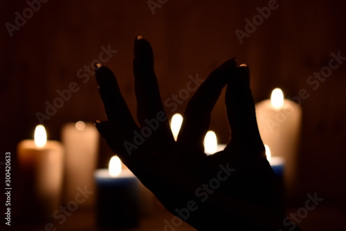 Photo Candles and fingers mudra