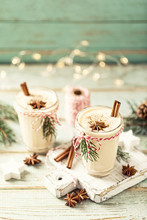 Eggnog. Traditional Christmas Drink, Spiced Egg-milk Cocktail With Nut Topping.