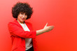 Leinwanddruck Bild - young pretty afro woman smiling, greeting you and offering a hand shake to close a successful deal, cooperation concept