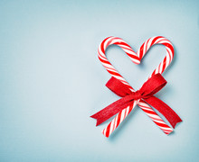 Christmas Candy Cane Heart On A Blue Background