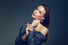 Young Celebrity Woman In Glitt...