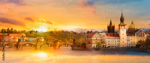 Obraz Scenic summer view of the Old Town buildings, Charles bridge and Vltava river in Prague during amazing sunset, Czech Republic - fototapety do salonu