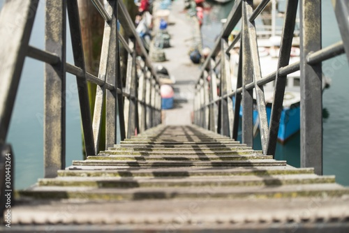 Bailey bridge with metal railings over the sea on a blurred background Wallpaper Mural