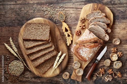 Tuinposter Brood Healthy wholegrain sliced loaf with walnut & fig rye bread. High in vitamins, antioxidants and omega 3 with low gi. Health food to reduce high blood pressure, cholesterol and optimise a healthy heart
