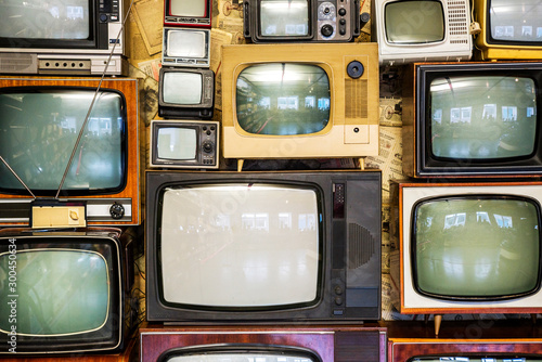 Valokuva  Many old televisions bundled together