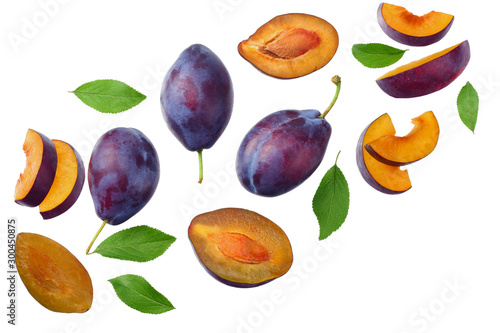 Stampa su Tela fresh plum fruit with green leaf and cut plum slices isolated on white background