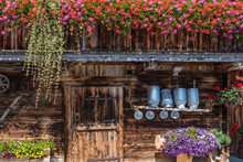 Flowers At The Wooden Farmhouse