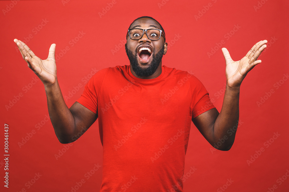 Fototapeta Portrait of excited young African American male screaming in shock and amazement. Surprised black hipster looking impressed, can't believe his own luck and success.
