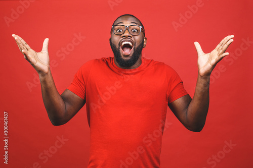 Fotografija  Portrait of excited young African American male screaming in shock and amazement