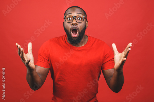 Portrait of excited young African American male screaming in shock and amazement Fototapeta